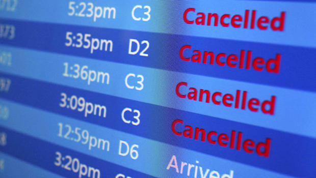 Canceled flights are displayed on a status board at New York's Laguardia Airport ahead of a powerful winter storm Jan. 22, 2016.
