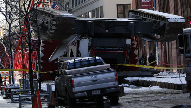 A construction crane lies on a street in downtown Manhattan in New York on Feb. 5, 2016.