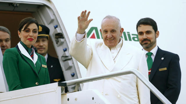 Pope Francis waves as he boards a plane at Fiumicino Airport in Rome, Italy, Feb. 12, 2016.