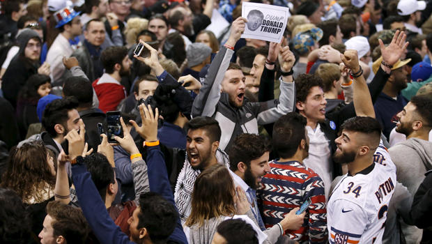 Demonstrators cheer after Republican presidential candidate Donald Trump canceled his rally at the University of Illinois at Chicago March 11, 2016.