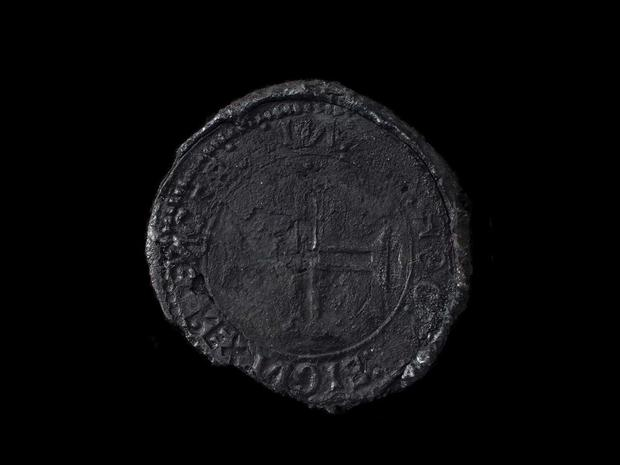 A rare Indio silver coin, dating back to 1499, recovered from a shipwreck off the coast of Oman