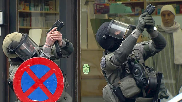 Armed Belgian police secure the area in this still image taken from video upon their arrival in the Molenbeek neighborhood of Brussels, Belgium, March 18, 2016.