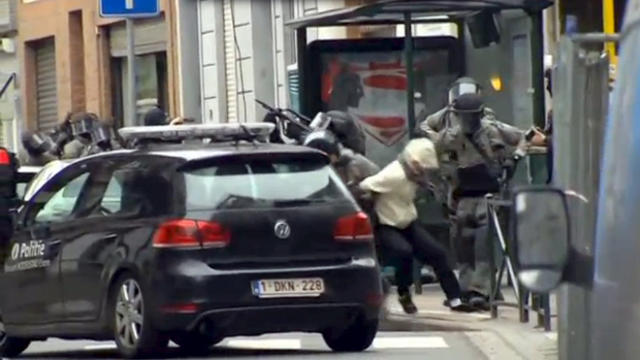 ​Armed Belgian police apprehend a suspect in this still image taken from video in the Molenbeek neighborhood of Brussels, Belgium, March 18, 2016.