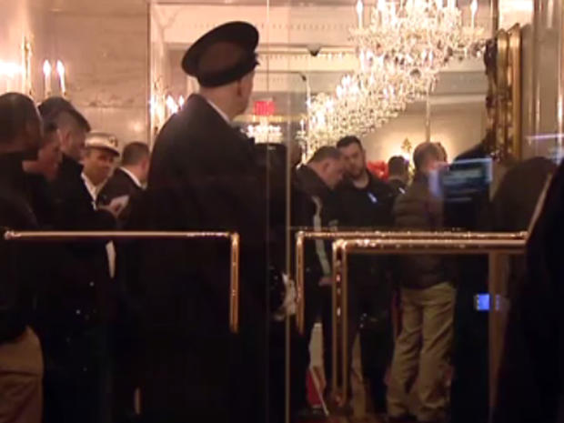 Investigators in crowded lobby of 100 Central Park South in Manhattan late on March 17, 2016 after what sources say was threatening letter was received by Donald Trump's son, Eric Trump
