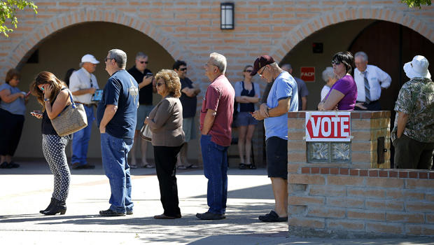 Voters wait in line to cast their ballot in Arizona's presidential primary election March 22, 2016, in Gilbert, Ariz.
