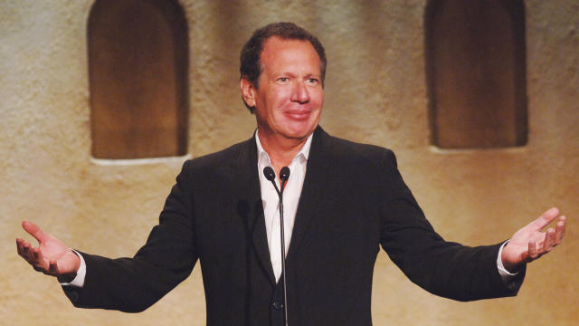 Actor Garry Shandling gestures at the fifth annual Project A.L.S. benefit gala in Los Angeles May 6, 2005.
