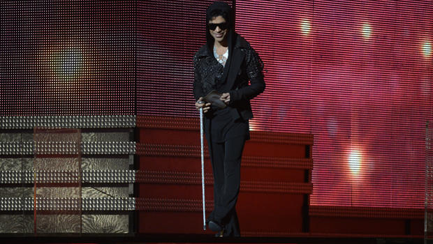 Musician Prince arrives to present the winner for Record of the Year on stage at the Staples Center during the 55th Grammy Awards in Los Angeles, California, Feb. 10, 2013.