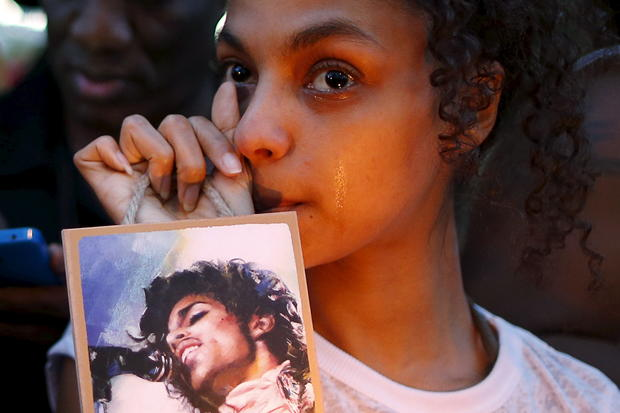 Julya Baer, 30, cries at a vigil to celebrate the life and music of deceased musician Prince in Los Angeles April 21, 2016.
