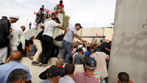 Followers of Iraq's Shiite cleric Muqtada al-Sadr storm Baghdad's Green Zone after lawmakers failed to convene for a vote on overhauling the government in Iraq April 30, 2016.