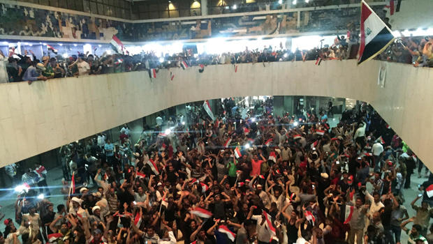 Followers of Iraq's Shiite cleric Muqtada al-Sadr are seen in the parliament building as they storm Baghdad's Green Zone after lawmakers failed to convene for a vote on overhauling the government in Iraq April 30, 2016.