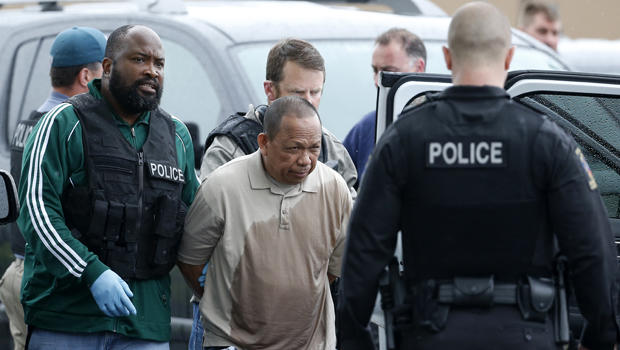 ​Police take Eulalio Tordil, 62, a suspect in three fatal shootings in the Washington, D.C., area into custody in Bethesda, Md., May 6, 2016.