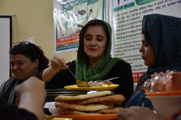 "​Ilham interpreter and employee Zoha (center), who always wanted to be a journalist to tell ""real stories"" of Afghanistan, with UNHCR coordinator Aditi Sabbarwal (left) and other Ilham member Ziaul"