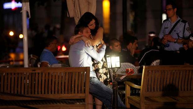 People hug each other following a shooting attack that took place in the center of Tel Aviv on June 8, 2016.