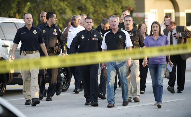 Orlando Mayor Buddy Dyer, center right, and Orlando Police Chief John Mina, center left, arrive to a news conference after a fatal shooting at Pulse nightclub in Orlando, Florida, on June 12, 2016.