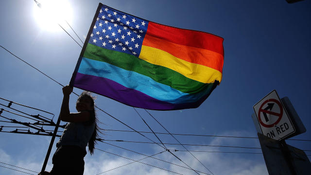 A same-sex-marriage supporter waves a pride flag while celebrating the U.S Supreme Court ruling regarding same-sex marriage on June 26, 2015, in San Francisco, California.