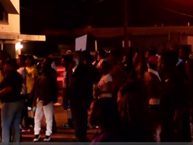 Demonstrators protesting late on July 5, 2016 outside convenience store after suspect was shot and killed by Baton Rouge, Louisiana police much earlier in the day