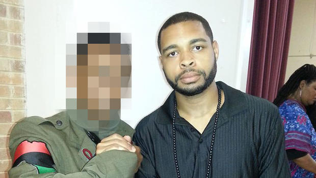 ​Micah Xavier Johnson, right, is seen in a photo obtained by CBS News.