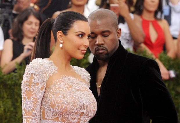 May 2015 file photo shows Kim Kardashian and Kanye West arriving at The Metropolitan Museum of Art's Costume Institute benefit gala in New York