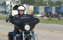 VP candidate Mike Pence takes a spin on a Harley