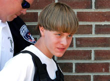 Police lead suspected shooter Dylann Roof into the courthouse in Shelby, North Carolina, on June 18, 2015.