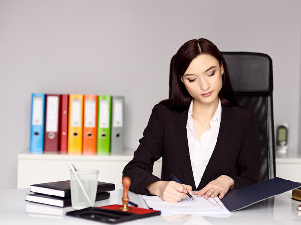 Woman notary public notarizes the document