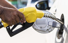 Gas heading south of $2 per gallon, and other MoneyWatch headlines