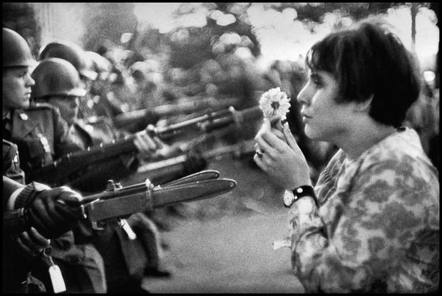 Image result for 0ffering flower vietnam protest