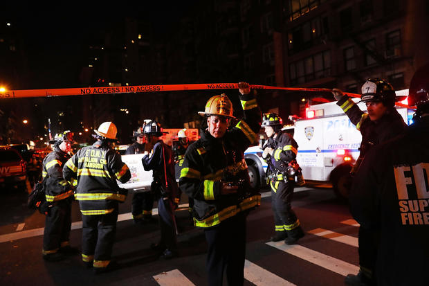 Police, firefighters and emergency workers gather at the scene of an explosion in Manhattan on Sept. 17, 2016, in New York City. The evening explosion at 23rd Street in the popular Chelsea neighborhood injured over two dozen people.