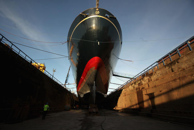 Workmen carry out painting and repairs on the Royal Yacht Britannia in a dry dock at Forth Ports