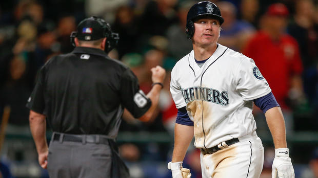 Steve Clevenger, No. 32 of the Seattle Mariners, heads back to the dugout after striking out with two runners on base to end the fifth inning against the Minnesota Twins at Safeco Field on May 28, 2016, in Seattle, Washington.