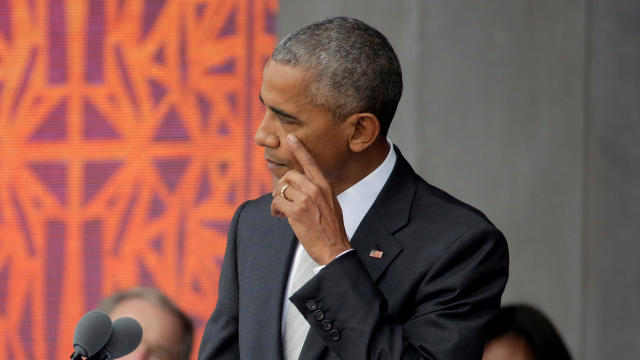 President Obama wipes his cheek as he speaks during the dedication of the Smithsonian's National Museum of African American History and Culture in Washington, Sept. 24, 2016.