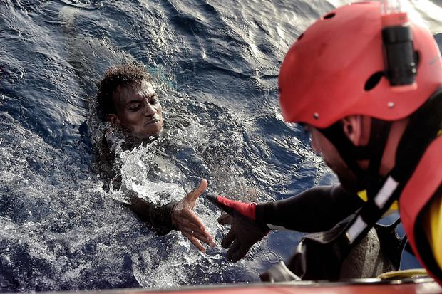Migrant boat sinks off Tunisia, at least 70 dead