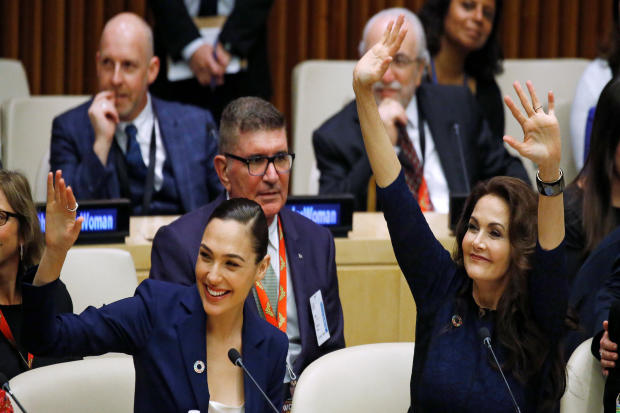 Actors Gal Gadot and Lynda Carter wave during an event to name Wonder Woman the U.N. honorary ambassador for the empowerment of women and girls at the United Nations headquarters in the Manhattan borough of New York Oct. 21, 2016.