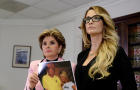 Lawyer Gloria Allred, left, holds a photograph of Jessica Drake and Donald Trump, taken in 2006 at a golf tournament in Lake Tahoe, California, after she spoke to reporters about allegations of sexual misconduct against Trump in Los Angeles, California, O