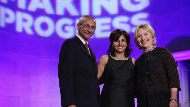 From left to right, Center for American Progress co-founder John Podesta, President Neera Tanden and former Secretary of State Hillary Clinton pose for photographs during a gala celebrating the 10th anniversary of the center at the Mellon Auditorium Oct.