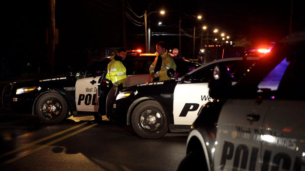 """Police in Urbandale, Iowa, set up a blockade after two police officers were shot and killed in separate attacks described as """"ambush-style"""" in Des Moines, Iowa, Nov. 2, 2016."""