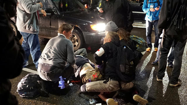 A demonstrator is treated for a gunshot wound during a protest against the election of Republican Donald Trump as president of the United States in Portland, Oregon, Nov. 12, 2016.