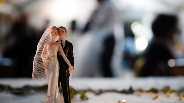 Bride and groom figurines are pictured on a table during a wedding party on Sept. 13, 2014, in Hede-Bazouges, a suburb of Rennes, France.