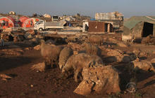 """""""Nothing but mud"""" for families in Syrian refugee camp"""