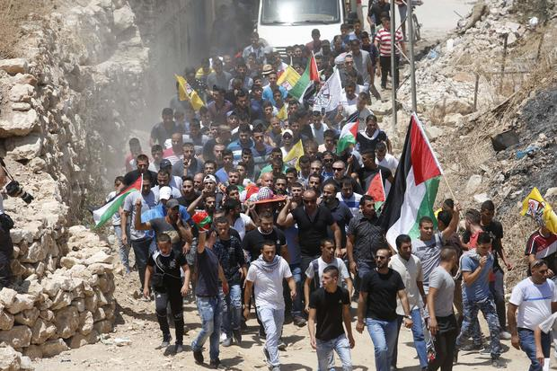 Mourners carry the body of Muhey al-Tabakhi, 12, during his funeral in the West Bank town of Al-Ram, near Jerusalem, July 20, 2016. A Palestinian hospital official says the boy was killed after clashes erupted between Israeli forces and protesters in the West Bank. Ramallah hospital director Ahmad Bitawi says the boy was killed by a bullet to the chest. Israeli police deny that live fire was used against protesters.