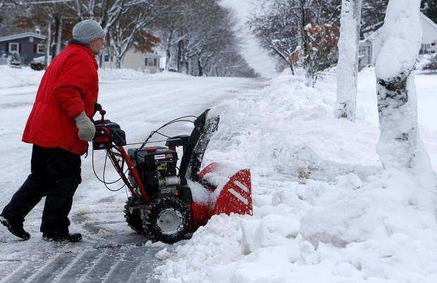 Tom Sargent pushes his snowblower up his driveway in Bangor, Maine, Dec. 30, 2016.