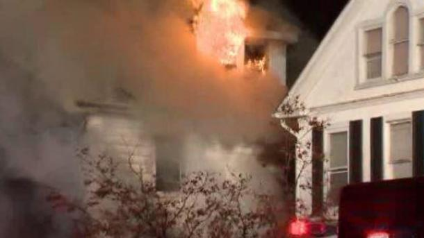 A three-story house burns in northeast Baltimore early Jan. 12, 2017.