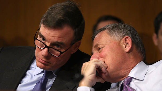 Sen. Mark Warner, left, D-Virginia, vice chair of the Senate Select Committee on Intelligence, and Sen. Richard Burr, R-North Carolina, the committee's chairman, speak in the Dirksen Senate Office Building on Capitol Hill Jan. 10, 2017, in Washington.