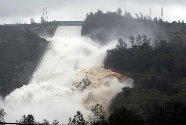 Water flows through a break in the wall of the Oroville Dam spillway Feb. 9, 2017, in Oroville, Calif.