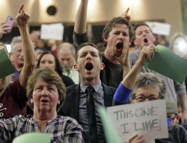People shout to Rep. Jason Chaffetz during his town hall meeting at Brighton High School Feb. 9, 2017, in Cottonwood Heights, Utah.