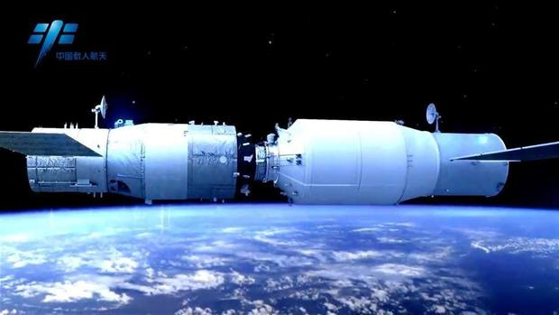 Artist's illustration showing China's Tianzhou-1 freighter docking with the currently orbiting Tiangong-2 space lab.               CMSE