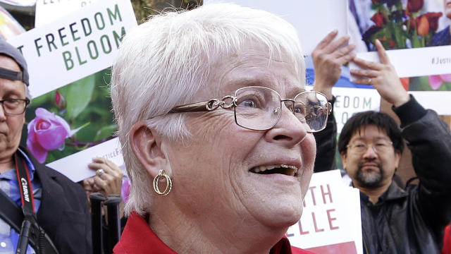 Barronelle Stutzman, center, a Richland, Wash., florist who was fined for denying service to a gay couple in 2013, reacts to being surrounded by supporters after a hearing before Washington's Supreme Court Nov. 15, 2016, in Bellevue, Wash.
