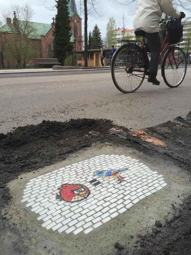 jim-bachor-pothole-art-birds-equals-2.jpg