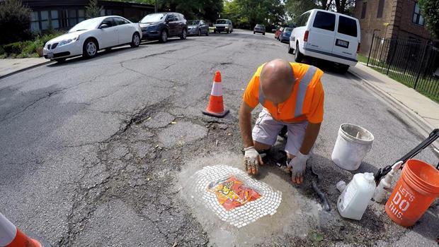 jim-bachor-working-on-pothole-mosaic-b-620.jpg