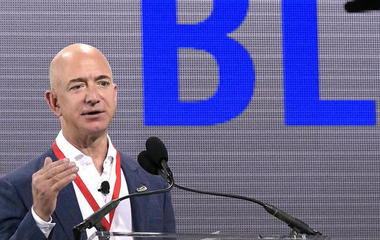 Billionaires Jeff Bezos and Elon Musk compete in space
